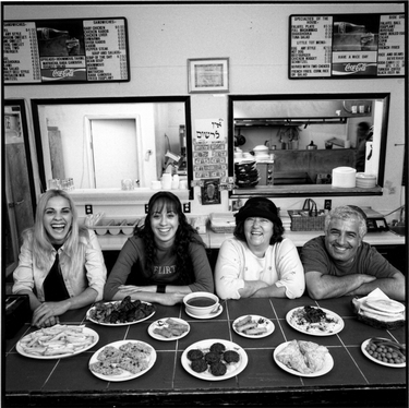 Photograph of Jerusalem Restaurant owners Nina and Yossi (Joseph) Elmalih, and Nina's neices, Hanni Logasy and Hanni Zohar.