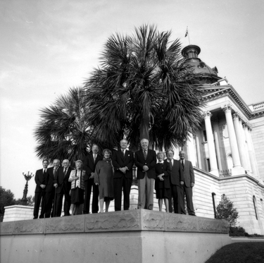 Photograph of present and past elected officials before the South Carolina State House