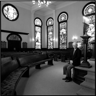 Photograph of Robert A. Moses inside Temple Sinai's sanctuary
